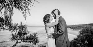 Surf club wedding kiss