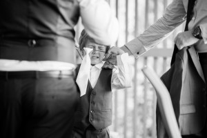 pageboy puts on tie
