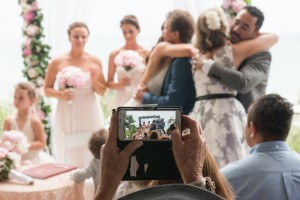 iphone capture bride and groom hugging family