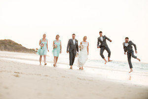 wedding group walk on beach