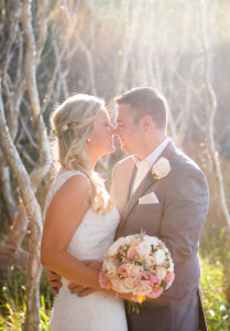 wedding couple kiss in trees