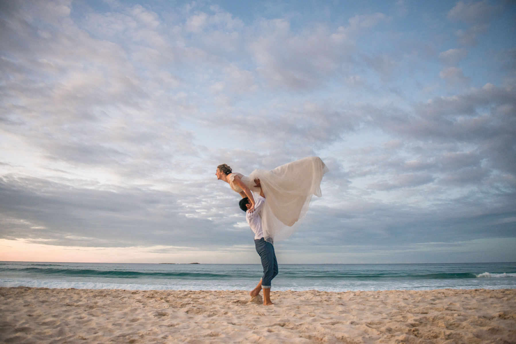 bride and groom dance move on beach
