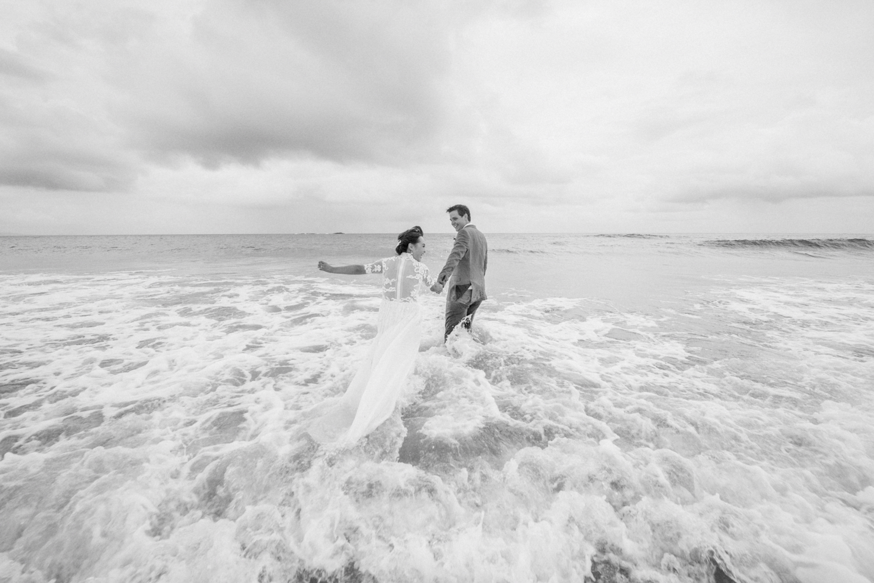 bride and groom swimming