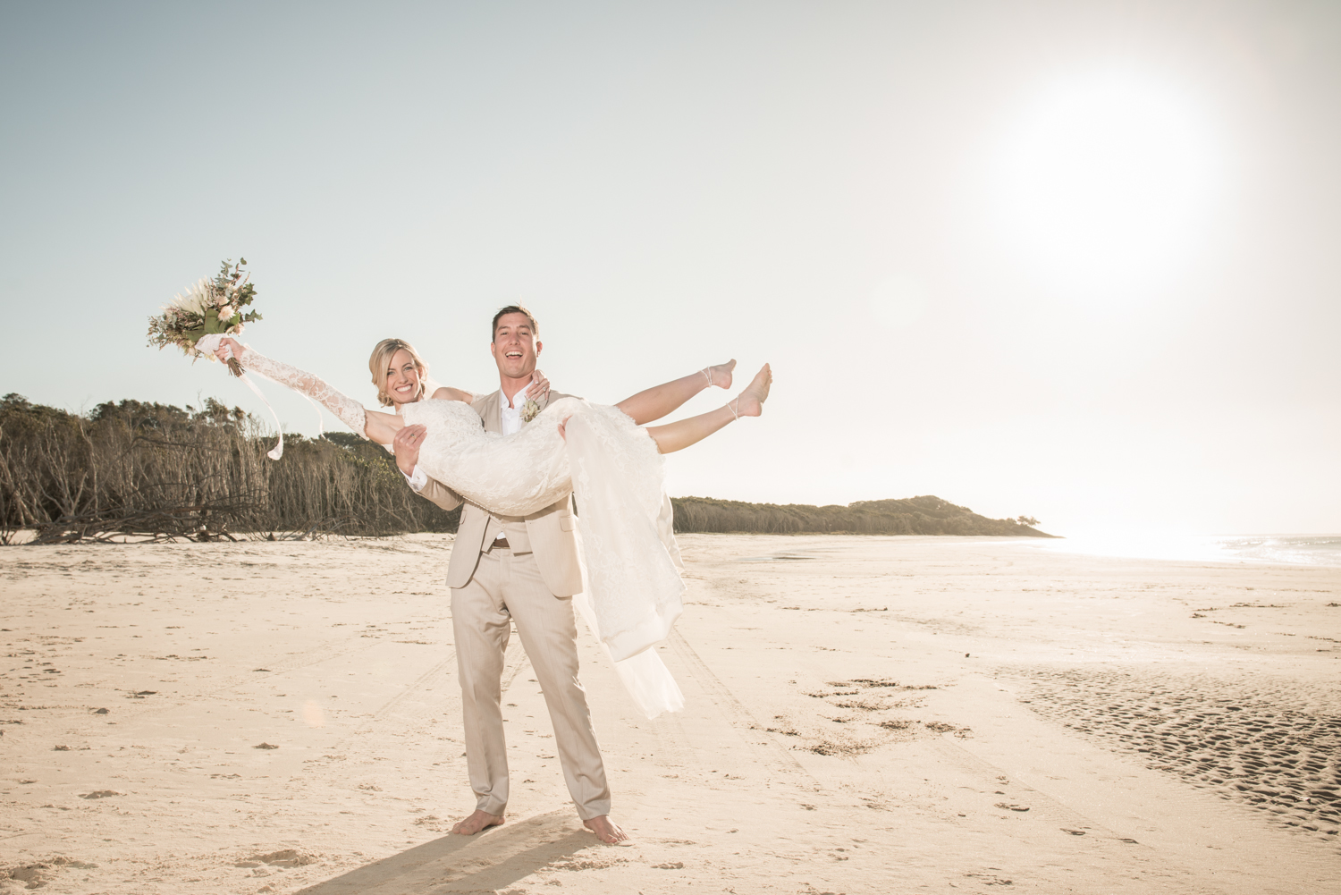 beach dancing and revelling after a wedding