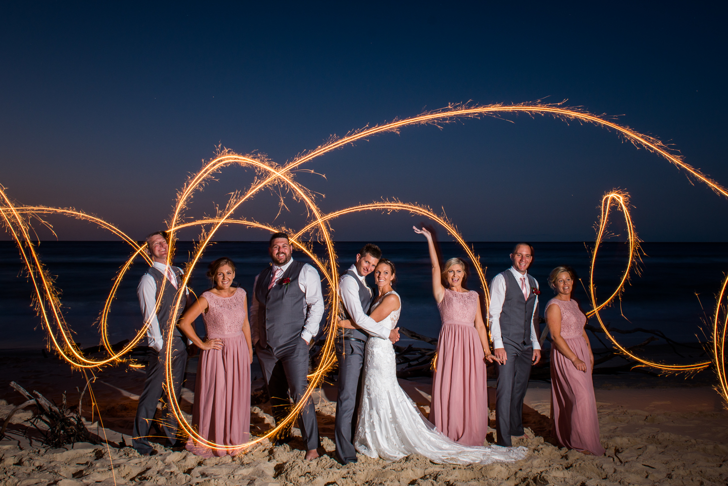 bridal party with sparklers