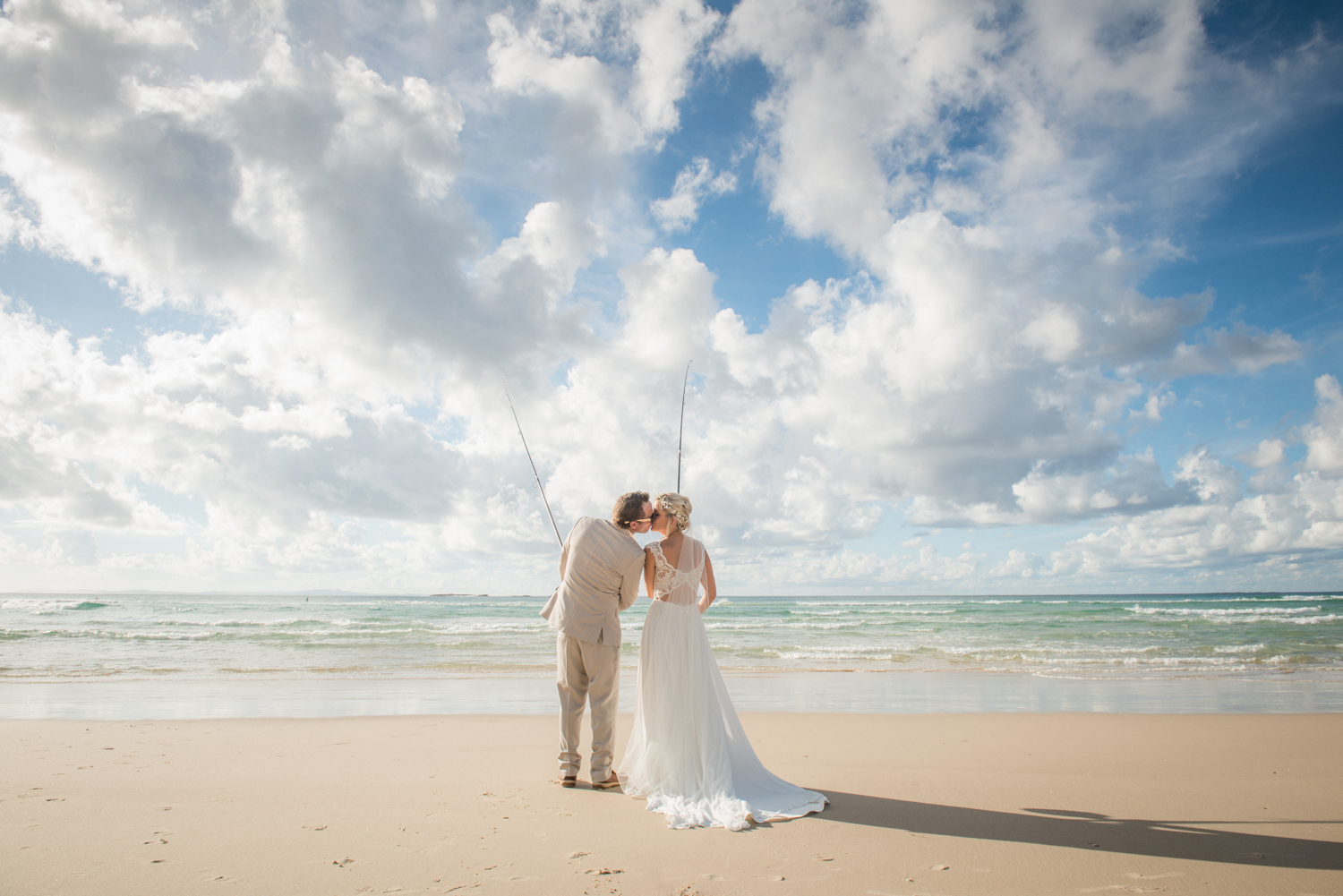 newlyweds fishing on beach
