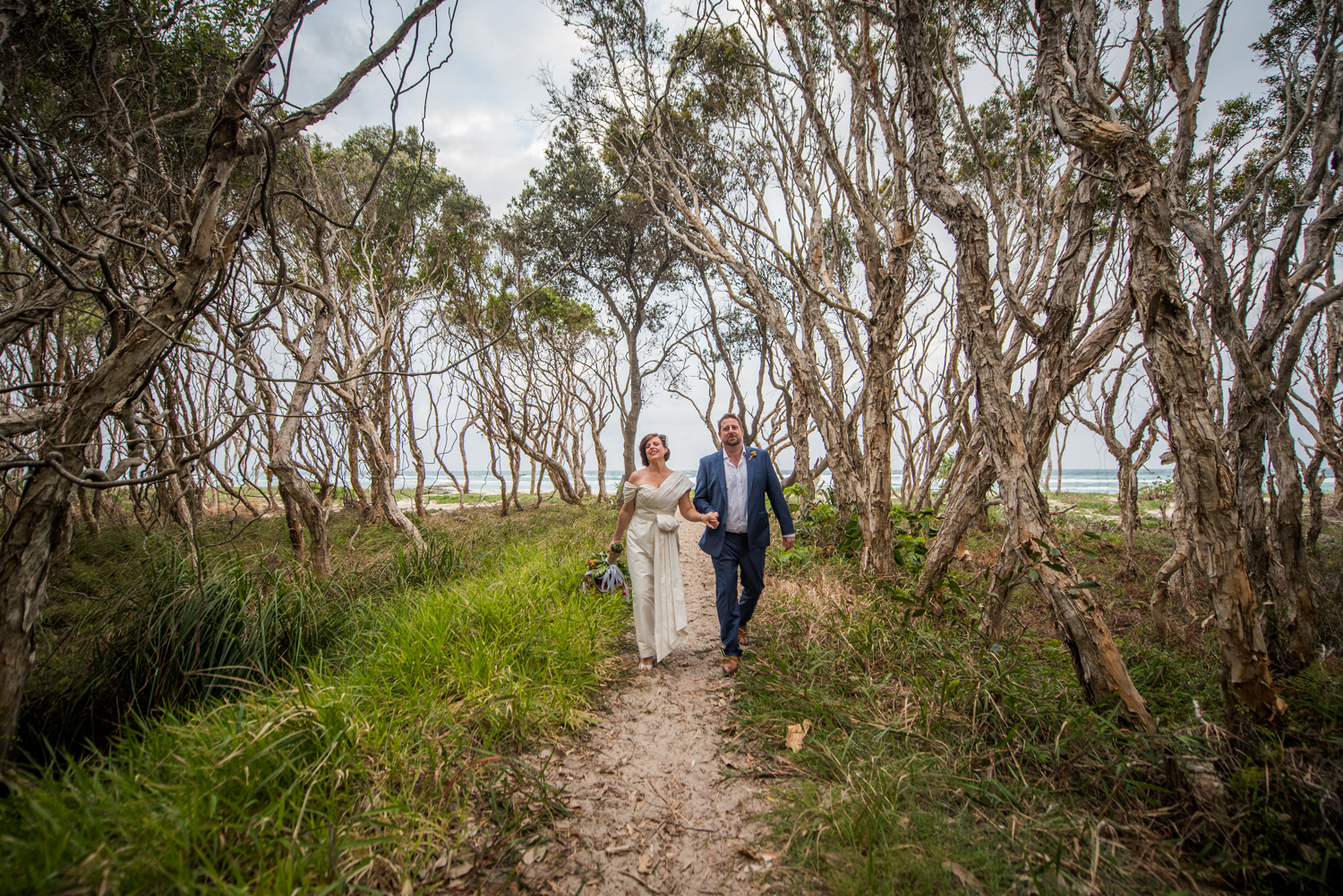 wedding couple on a beach path