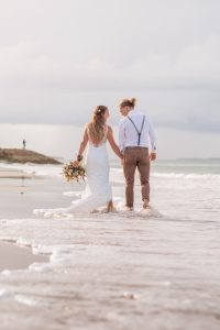 adventure couple trash the dress session on the beach at Straddie