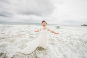Joan and Matt | jumping in the ocean in you wedding dress just minutes after getting married | North Stradbroke Island | stradbrokeislandphotography.com