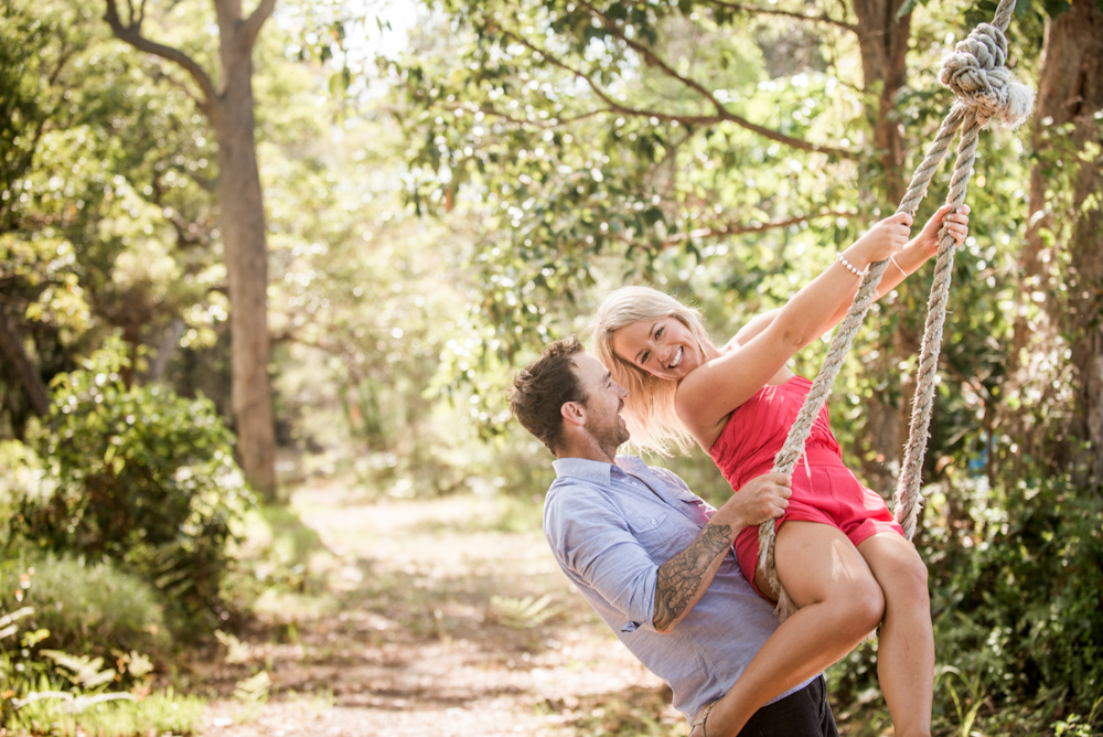 engagement couple on a tree swing