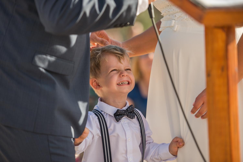 happy pageboy at parents wedding ceremony