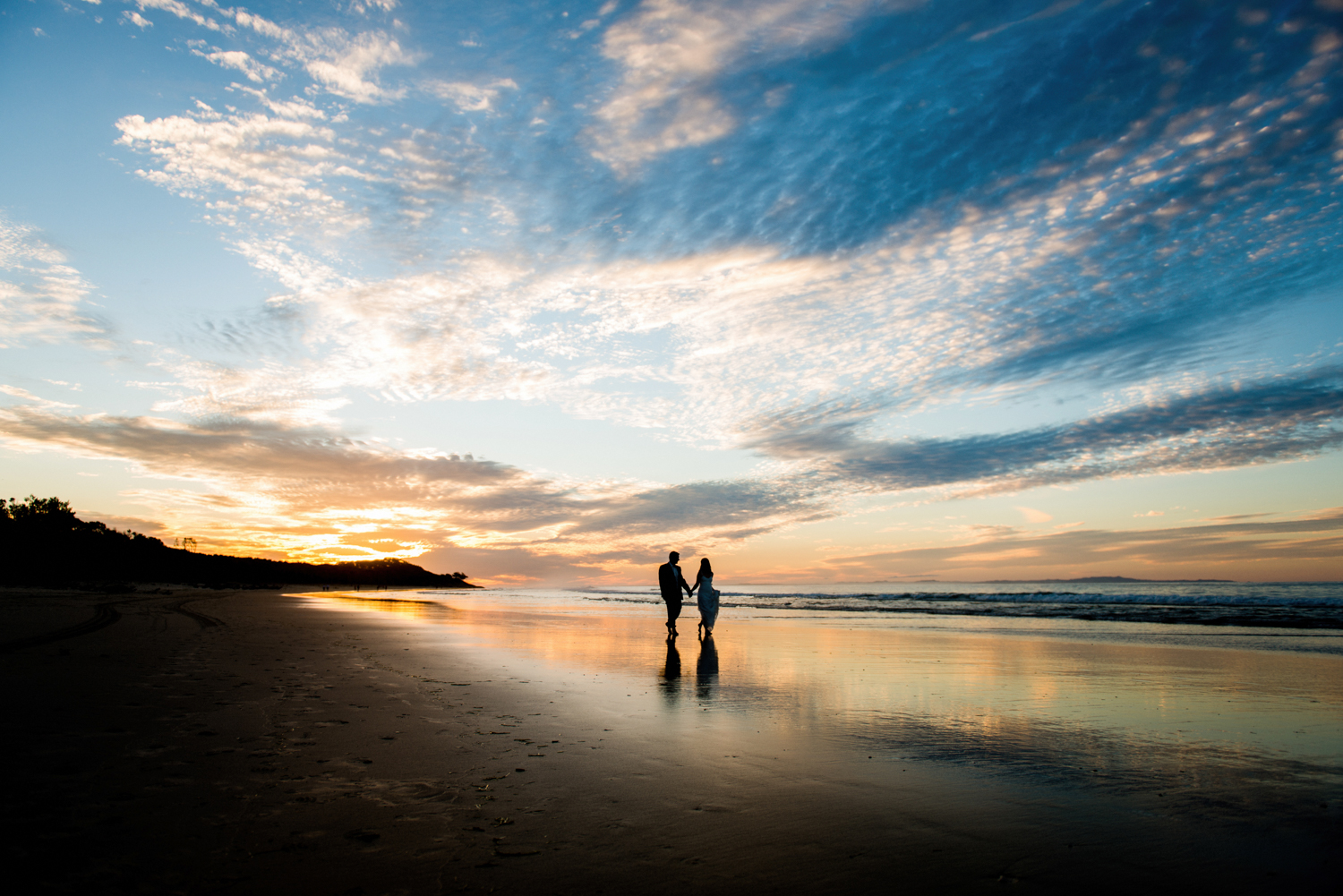 silhouette of bride and groom at sunset