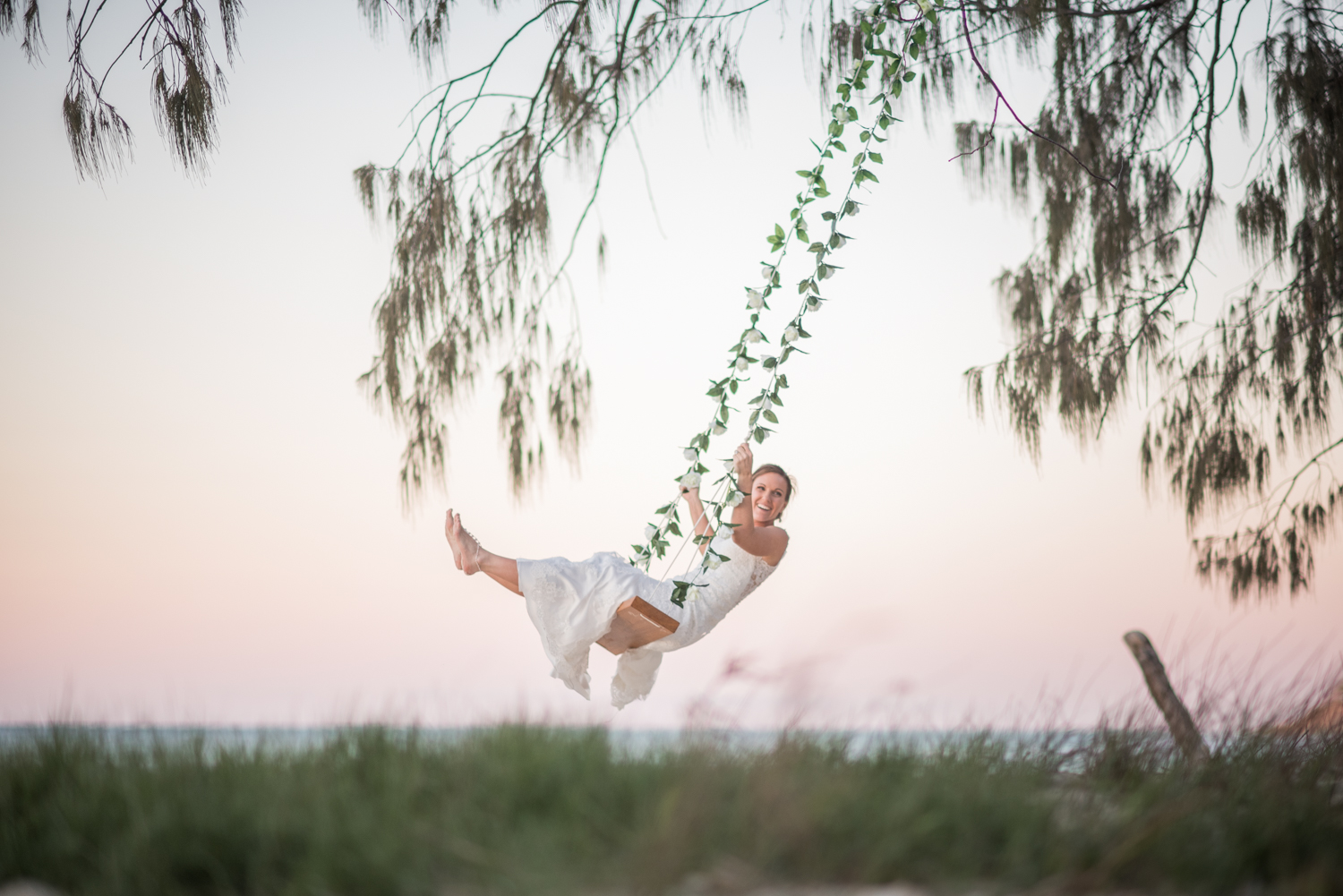 bride on a swing on the beach
