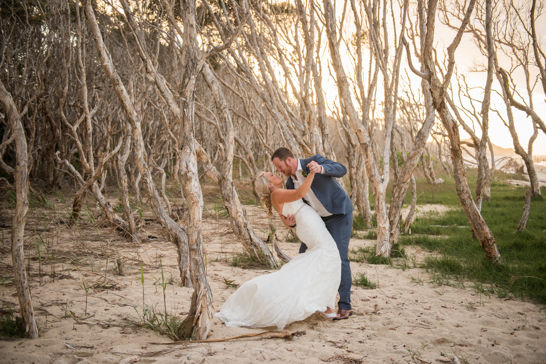 newlyweds in beachside paperbark trees