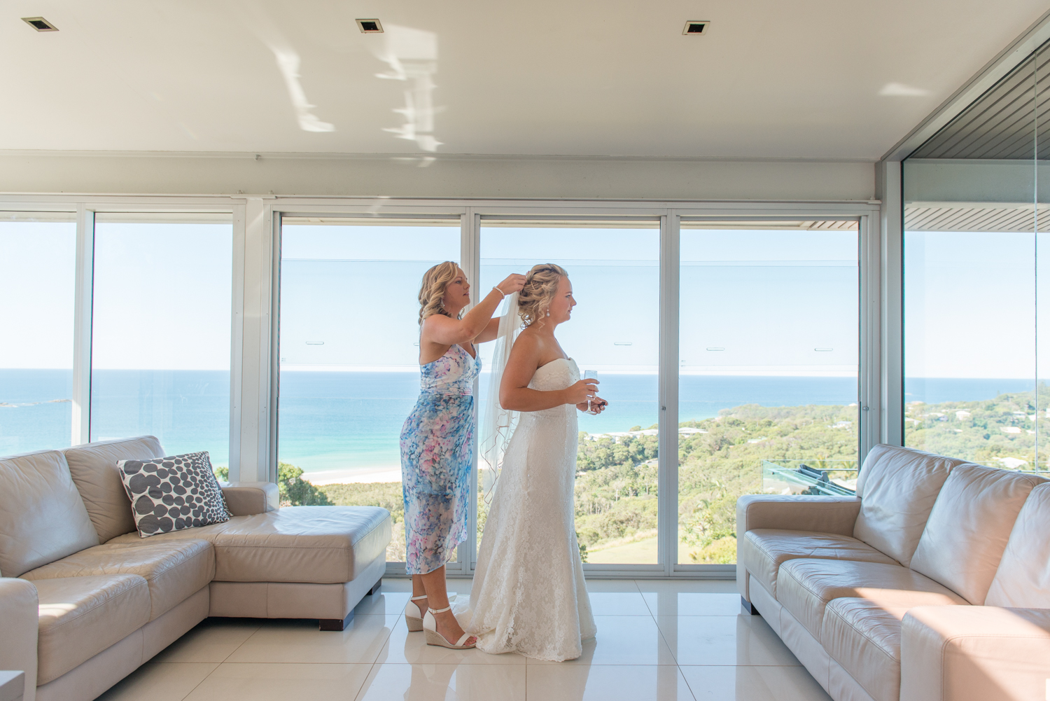 bride getting ready in a straddie holiday home