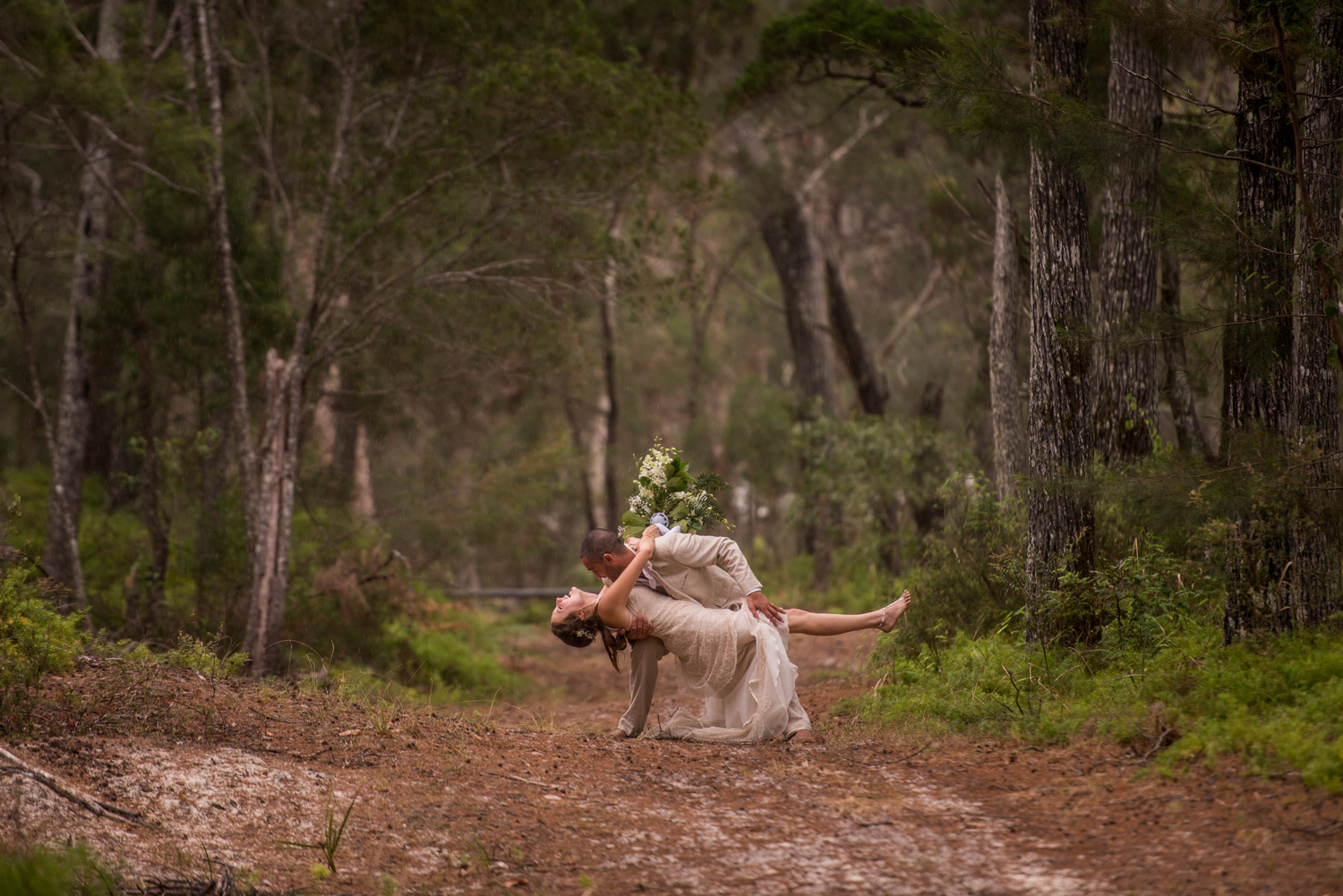 wedding couple dancing in the forest